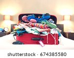 open suitcase on bed | Shutterstock . vector #674385580