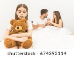 the sad girl with a toy sit... | Shutterstock . vector #674392114