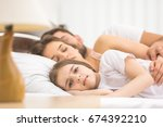 the girl lay near the sleeping... | Shutterstock . vector #674392210
