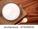 white creamy homemade yogurt on ... | Shutterstock . vector #674398534
