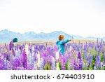 person enjoy lupin   lupine  ... | Shutterstock . vector #674403910