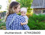 beautiful woman holding her... | Shutterstock . vector #674428600