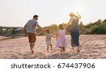 Small photo of Family playing on the beach