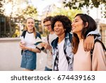 Stock photo college students walking together outdoors group of young people in college campus 674439163