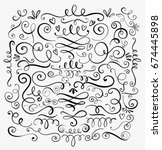 Hand drawn decorative curls and swirls. A collection of vintage vector design elements. Ink illustration. | Shutterstock vector #674445898