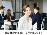 business woman with her staff ... | Shutterstock . vector #674460754