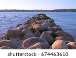 large stones by the beach at... | Shutterstock . vector #674463610