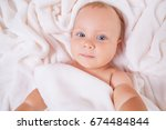 cute smiling baby under towel... | Shutterstock . vector #674484844