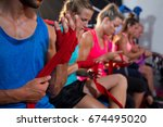 row of athletes wrapping... | Shutterstock . vector #674495020