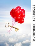 Small photo of opportunity concept illustrated with helium balloons carrying a golden key