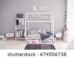 cozy children's bedroom in... | Shutterstock . vector #674506738