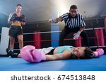 female boxer looking while... | Shutterstock . vector #674513848