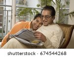 father and son reading the... | Shutterstock . vector #674544268