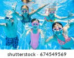 little kids swimming  in pool ... | Shutterstock . vector #674549569