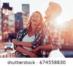 happy young couple having fun... | Shutterstock . vector #674558830