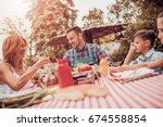 happy young family having lunch ... | Shutterstock . vector #674558854