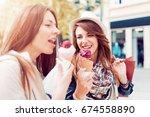 beautiful girls with shopping... | Shutterstock . vector #674558890