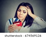 Stressed Woman In Debt Holding...