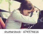 stressed woman driver sitting... | Shutterstock . vector #674574616