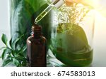 scientist with natural drug... | Shutterstock . vector #674583013