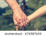 an old man and a kid holding... | Shutterstock . vector #674587654