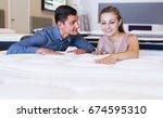 married couple choosing new... | Shutterstock . vector #674595310