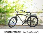 vintage khaki bike in the... | Shutterstock . vector #674623264