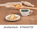 hot and fresh green tea on wood ... | Shutterstock . vector #674626720