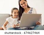 mom teaching daughter working... | Shutterstock . vector #674627464