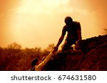 silhouette of the man climbing...
