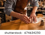 close up of a shoemaker cutting ... | Shutterstock . vector #674634250