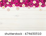 border made of garden flowers... | Shutterstock . vector #674650510
