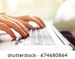 hands with laptop typing | Shutterstock . vector #674680864
