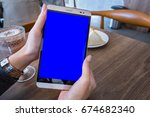 woman hand holding mobile phone ... | Shutterstock . vector #674682340