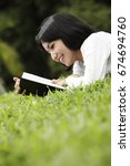 young woman reading outdoor