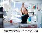 female executive doing yoga on... | Shutterstock . vector #674699833