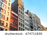 row of tall historic buildings... | Shutterstock . vector #674711830