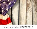 creased us flag against wood... | Shutterstock . vector #674712118