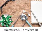 doctor desk with stethoscope ... | Shutterstock . vector #674722540