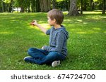 child playing with spinner... | Shutterstock . vector #674724700
