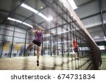 woman smashing ball in paddle...   Shutterstock . vector #674731834