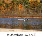 Skiff against fall backdrop - stock photo