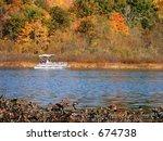 Autumn lake with pontoon boat - stock photo