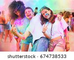 friends at holi party covered... | Shutterstock . vector #674738533