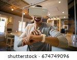 smiling man using virtual...   Shutterstock . vector #674749096