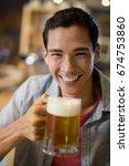 portrait of man having beer in... | Shutterstock . vector #674753860