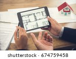 real estate agent with client... | Shutterstock . vector #674759458