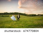 wedding couple on nature. | Shutterstock . vector #674770804