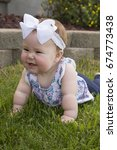 a beautiful baby girl laying on ... | Shutterstock . vector #674773438