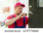 locksmith in red uniform... | Shutterstock . vector #674774860